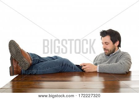 happy man on a desk with a tablet pc, isolated