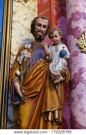 KRAPINA, CROATIA - APRIL 21: Saint Joseph holding baby Jesus statue at the altar in the church of Saint Catherine of Alexandria in Krapina, Croatia on April 21, 2016.
