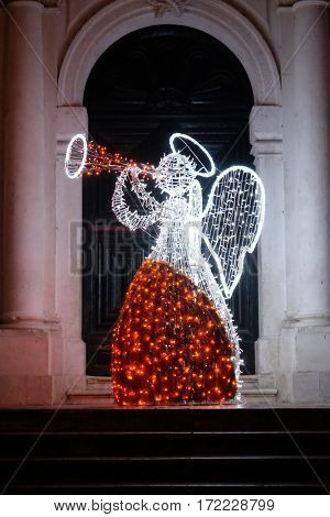DUBROVNIK, CROATIA - DECEMBER 01: Christmas angel decorated with lights and ornaments, shining in the romantic atmosphere, Dubrovnik, Croatia on December 01, 2015.
