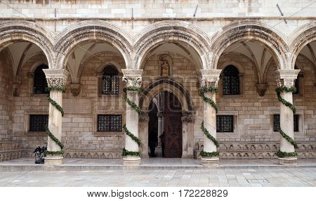 DUBROVNIK, CROATIA - DECEMBER 01: Columns and exterior of the Duke's Palace (Knezev dvor) decorated with Advent wreaths in Dubrovnik, Croatia on December 01, 2015.