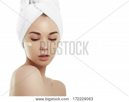 Spa Girl. Beautiful Young Woman After Bath Touching Her Face With Cosmetic Cream. Perfect Skin. Skin