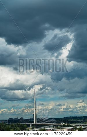 Dark rainy clouds over cable bridge in Belgrade, Serbia