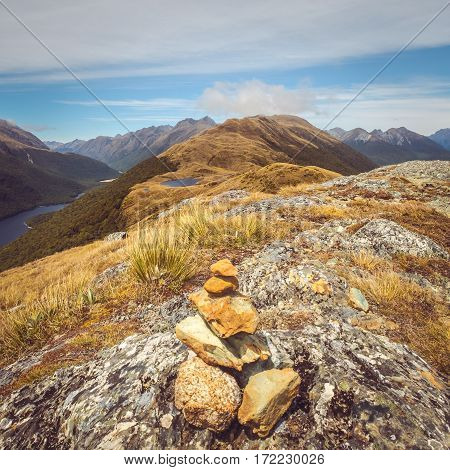 Landscape View Of Small Rocks Pyramid And Mountain Range, Nz