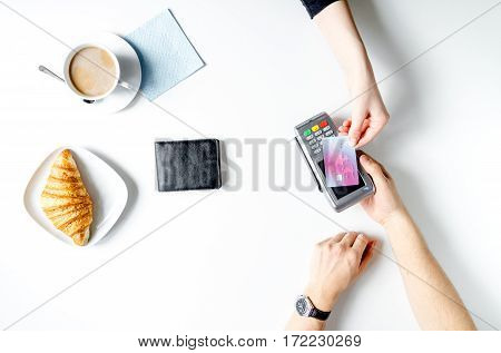 Croissant and coffee business breakfast on white table background payment by credit card in cafe top view