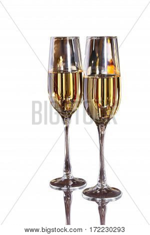 Two Glass of wine, brandy or cognac on white background.