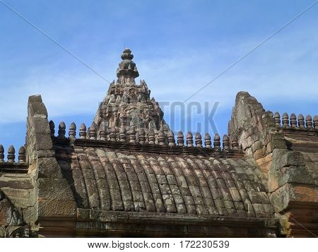 Impressive Roof details of Ancient Khmer Temple against sunny blue sky, Phanom Rung Historical Park, Thailand