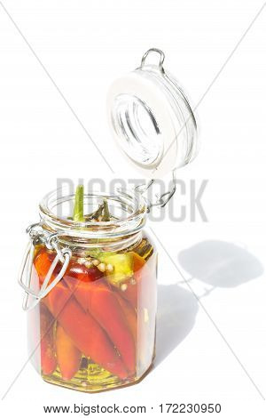 Chilly peppers with spices in a glass jar