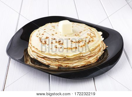 Pancakes With Butter In  Platter On White Background