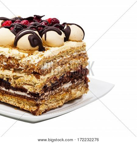 Layer Cake with Cranberry and Chocolate Isolated on a white background. Selective focus.