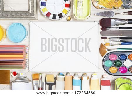 The various painting equipment on wooden  background