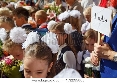 BALASHIKHA/ RUSSIA - SEPTEMBER 1, 2016: A teacher holds a sign with the inscription