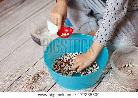 Child Boy Playing With Beans