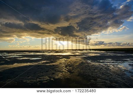 Sundown at low tide at the North Sea St. Peter-Ording Germany