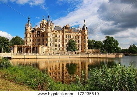 Schwerin Castle (Schweriner Schloss) reflected in the lake, Germany