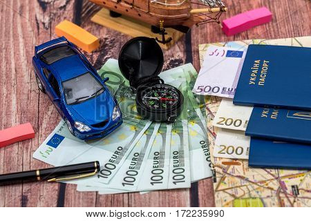 Euro Bills For A Travel, Car, Maps, Passport, And Other Stuff For Adventure On The Table.