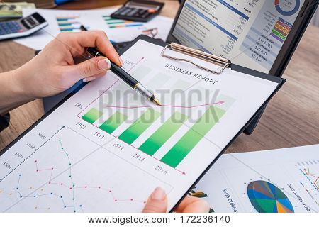 Business Woman Working With Business Graph At Office, Financial Report Concept.