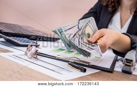 Business Woman Showing How Much Money Is Left After The Terms Of The Budget Year.