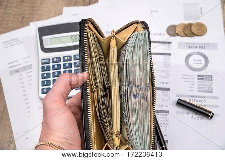 businessman count money above paperwork. finance concept.