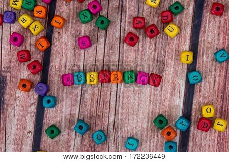abstract - word created with colored wooden cubes. Stock Photo.