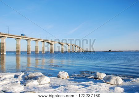 Icy coast by the Oland Bridge in Sweden one of the longest bridges in Europe. The bridge is connecting the swedish island Oland with mainland Sweden.
