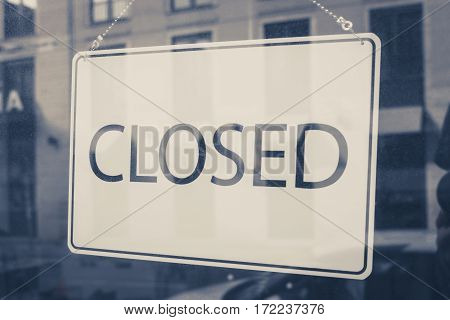 closed sign in shop entrance door - store closed