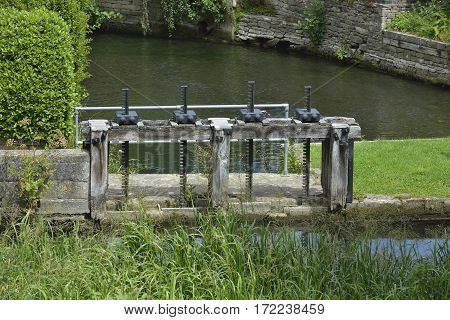 Mill Pond with Sluice Gate Winding Gears Brimscombe Mill Stroud Gloucestershire