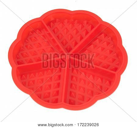Red silicone form Viennese wafers. Studio Photo