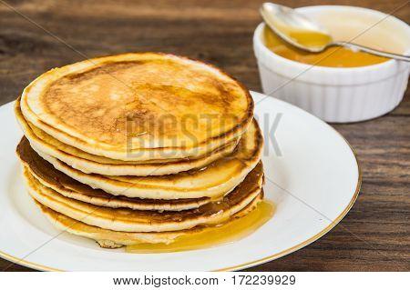 Hot Pancake with fragrant honey. Studio Photo