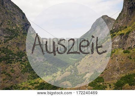 German Text Auszeit Means Downtime. Valley With Mountains In Norway. Peaceful Landscape, Scenery With Grass, Trees And Rocks.