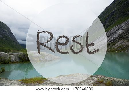 English Text Rest. Lake With Mountains In Norway. Cloudy Sky. Peaceful Scenery, Landscape With Rocks And Grass. Greeting Card