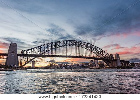 Australian Iconic Landmark Sydney Harbour Bridge Against Picturesque Sunset Sky