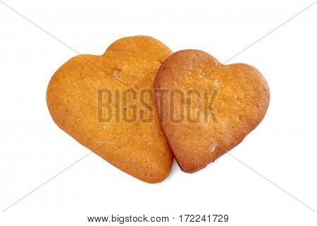 Two heart shaped gingerbread cookies isolated on white background