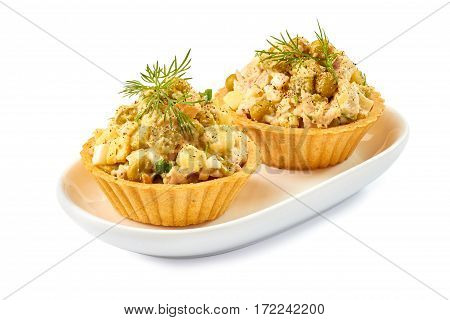 Two tartlets with ham salad isolated on white background
