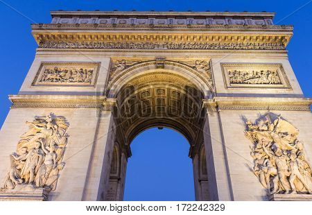 The Triumphal Arch in evening Paris France.