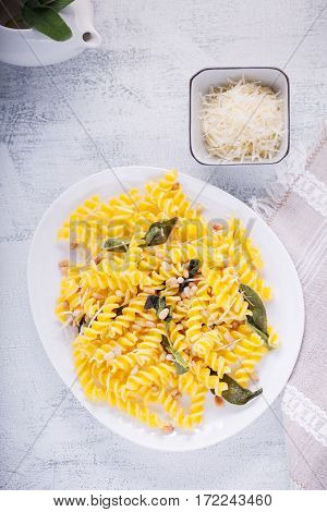 Fusilli pasta with sage and pine nuts. Gluten free. Flour from rice and corn flour