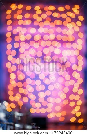 holidays, background and illumination concept - blurred golden christmas decoration or garland lights bokeh.