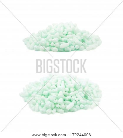 Pile of bioplastic packing foam peanuts isolated over the white background, set of two different foreshortenings