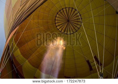 A view of a hot air balloon from underneath