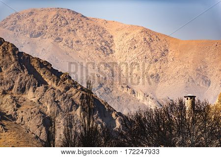 High rocky mountains of Iran are surrounding ascetic tower