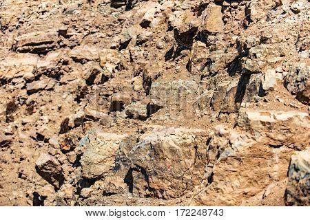 Bizarre play of light on ocher rough stones