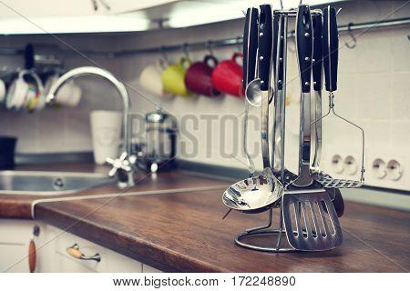 Kitchen Utensils On  Work Top