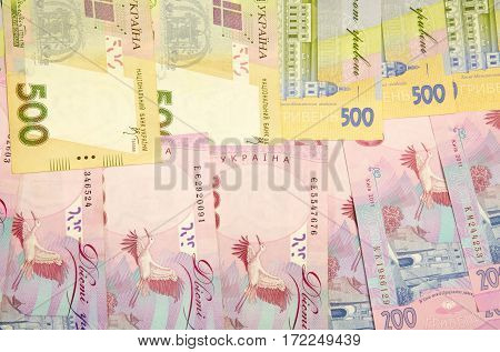 Background of banknotes nominal value of five hundred and two hundred hryvnia.