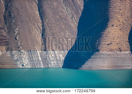 High strong mountains are beside blue clear aqua of magnificent lake