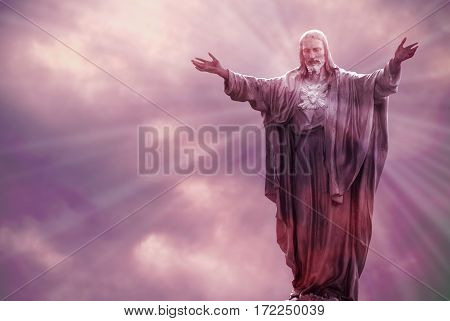 Jesus Christ in Heaven with rays of light religion concept