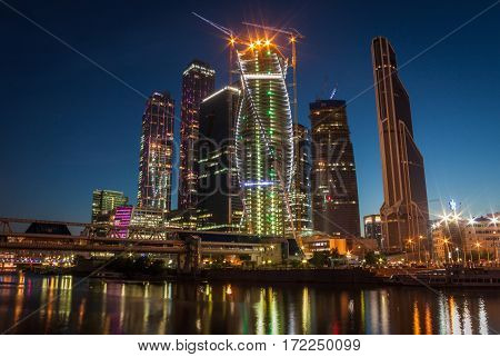 Moscow night landscape with river and moscow-city buisness center