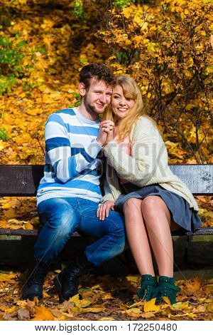 Lovers Couple In Autumn Park On Bench