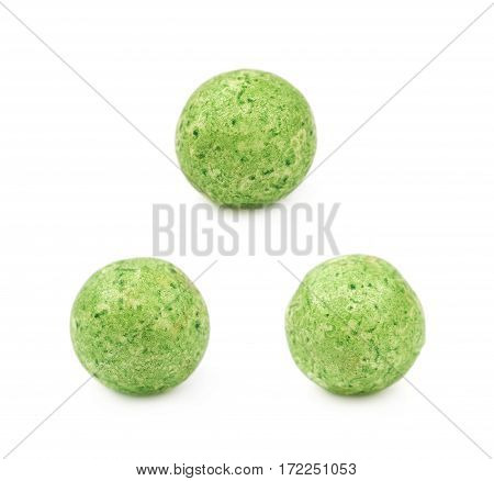 Single green colored foam ball or a corn cereal candy isolated over the white background, set of three different foreshortenings