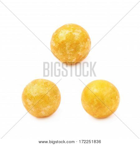Single yellow colored foam ball or a corn cereal candy isolated over the white background, set of three different foreshortenings