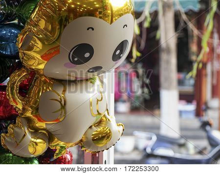 A golden monkey balloon is on sale in China for Chinese New Year.