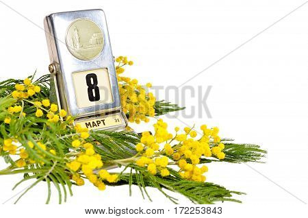 8 March card - vintage desk calendar with 8 March date and mimosa flowers isolated on white background. 8 March festive background with 8 March date